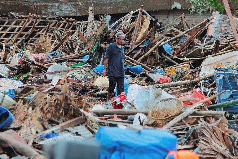 Villager of Petobo walk to search for stuff belong to them.